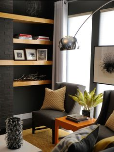A floor lamp with marble base and stainless steel telescopic stem illuminates a seating area. - Paint pick: Sherwin-Williams Grizzle Gray