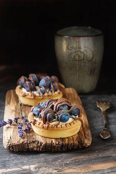 Lemon tartlet pie tart with fresh blueberries and milk chocola by ngaus