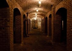 MARKET STREET CATACOMBS -INDIANAPOLIS Tunneled beneath the city streets with limestone and brick archways, the catacombs were used to transport and store meats and produce to be sold in the market before the days of refrigeration. Dungeons And Dragons, Brick Archway, All The Bright Places, The Catacombs, Indianapolis Indiana, Unusual Things, Places Of Interest, Weekend Trips, City Streets