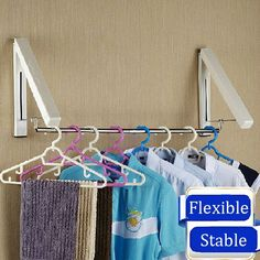 Creative Wall Mounted Retractable Foldable Clothes Rack Magic Hanger Storage Holder