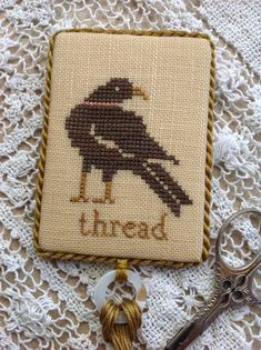 Hand stitched cross stitched black crow thread by TheOldNeedleShop