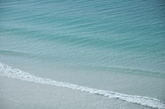 Shades of blue water on the beautiful coast of the Florida panhandle by Wellspring Images.
