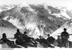 On 22 December 1942, German soldiers from the mountain troops, in the snow having a rest, Caucasus, Soviet Union.