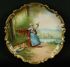 FINE HAND PAINTED PORCELAIN CHARGER DEPICTING A WOMAN IN A LANDSCAPE SETTING
