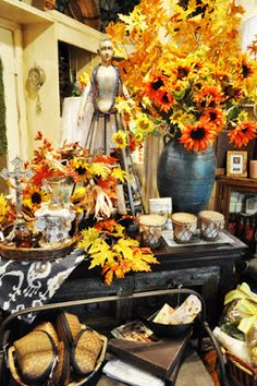 The shop is overflowing with FALL! Fall garlands, bittersweet garlands climbing here and there, tall maple leaf stems, and bright yellow, red, and orange sunflowers are our favorites. Red and orange clustered berry picks, orange tinted hops, queen anne's lace, and orange chinese lanterns are also pretty and unusual for the season ahead! Keep your faith cooler weather is just around the corner start making your home ready for the Fall season! www.bonnesamies.net