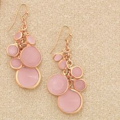 Fabulous in Pink Cluster Earrings. Nothing says flirty quite like a pop of pink! These rose-colored pieces are a perfect complement to today's feminine, romantic looks.