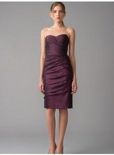 The strapless sweetheart neck dark purple taffets sheath knee-length bridesmaid dress with the natural ruches bodice and the sexy skirt