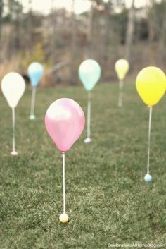 """Have little ones participating in this year's egg hunt? Balloon landmarks are a perfect way to ensure that they can join in on the fun too. Create a mini """"minefield"""" by tying a plastic egg onto the free end of a balloon string. Even the tiniest eyes won't miss 'em. Get the tutorial at Celebrations at Home »"""