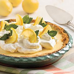 Zesty Lemon Pie | This recipe features from-scratch buttery crust, lemony-rich baked filling, and homemade whipped cream. | SouthernLiving.com