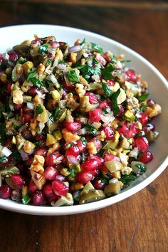 Green Olive, Walnut & Pomegranate Salad Source: Turquoise: A Chef's Travels in Turkey by Greg & Lucy Malouf  Notes: Use the amounts as a guide. I added a bit more of almost everything. Also, make sure the green olives are good. If you are able to taste them — from an olive bar, for example — before you buy them, that is ideal. Remember: if you don't like the olive before you chop it up and throw it in the salad, you probably won't like it any better when it's in the salad.  Substitutes for…