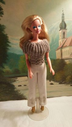 Crocheted sweater and comfy pants for Barbie with shoes