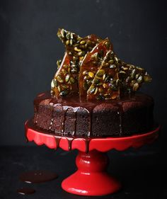 If you prefer savory to sweet, this cake's for you—a floral blend of herbs infuses the drippy chocolate glaze. The glimmering amber praline adds a dark, eerie element, and gives the almond-flour base some texture. The glamorous presentation makes it perfect for parties—just make sure to save a slice for yourself!