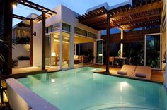An inspiration for a modern house with a pool feature. Definitely seems like something Don or the Caliente girls would live in.