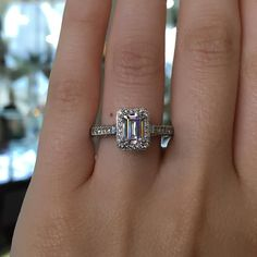 This beautiful petite Tacori Classic Crescent Diamond Halo Engagement Ring Setting can be customized to accommodate your desired and dream Emerald cut Diamond.