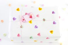 Create your own conversation heart wrapping paper with cute custom messages. Perfect for Valentine's Day!