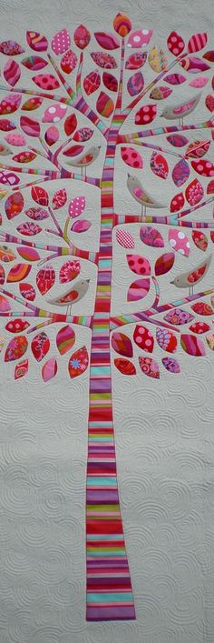 pretty wedding quilt idea, if you like applique. You could get family members from both sides to sign a piece of paper... then embroider that signature on a leaf.