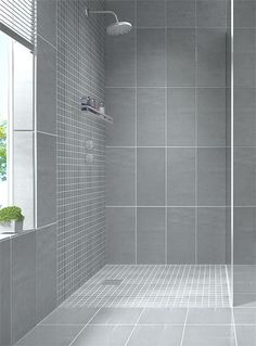 Create a modern looking bathroom by mixing different shapes of floor tiles, walls tiles & mosaic bathroom tiles in the same colour. Shown here: Zenith Cinza: