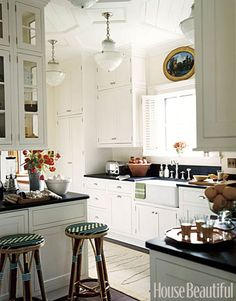 Not sure if this qualifies as a vintage-style kitchen, but certainly the light fixtures have a vintage look.