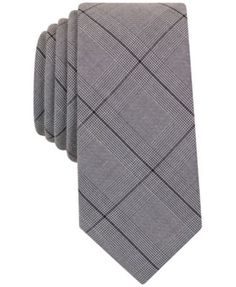 """Update your professional plaids with the clean pattern and slim design of this stylish Galvin tie from Bar Iii. 