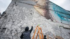A night raid by the artist erases twenty years of paintings on the city's walls in order to prevent them from ending up in a museum