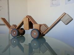 A mobile #Tegu Tegusaurus made from premium magnetic wooden building blocks in mahogany