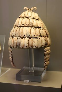 Boar's tusk helmet with cheek-guards and a double bone hook on top. Mycenae, 14th century BCE  (by mirth_matter)