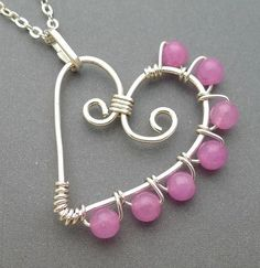 Neat idea for a wire work heart pendant! Love the wrapped beads and asymmetry! #jewelry #wirework