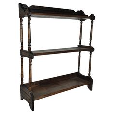 Vintage hanging bookcase with spooled columns.    Product: BookcaseConstruction Material: WoodColor: ...