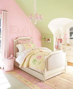 Fun idea of painting the right wall in her room a different color than the rest (it has two dormer windows and is slanted like the photo). I also like the mix of yellow, green and pink.