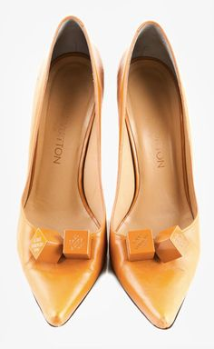 636bd8ad44 Louis Vuitton - they look like carmels on top! Yellow Pumps, Clothing  Company,
