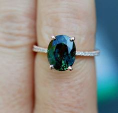 Green sapphire engagement ring. Peacock green sapphire 3.96ct