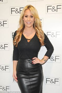 The 24-year-old TOWIE star wore a skin-tight leather pencil skirt with a plunging jumper which made the most of every inch of her stunning physique