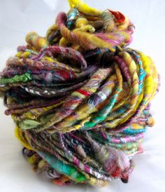bertie botts art yarn $25.00 love this...    Bertie Botts is a corespun art yarn consisting of every flavor fiber. This has alpaca, cashmere, merino, camel, sparkles, and about 10 other fibers. It is spun worsted to super bulky and is a fun yarn.