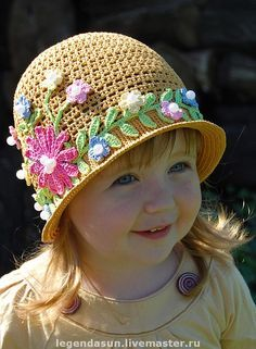 Cute hat, love the flower detail.  No pattern, just inspiration.