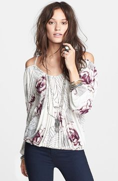 Free shipping and returns on Free People 'Adelia' Print Boho Blouse at Nordstrom.com. A striking floral motif punctuates this shoulder-flaunting blouse detailed with lace embroidery at the back and billowing sleeves.
