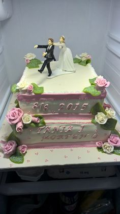 Wedding cake with marzipan cover and roses.