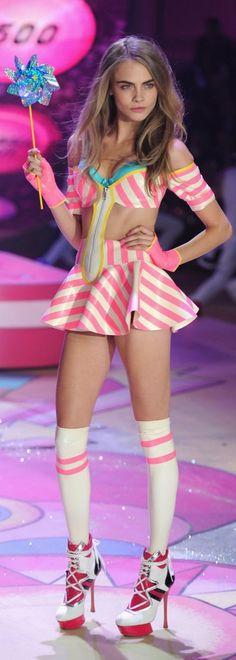 Cara Delevingne walking in the Victoria's Secret runway show.