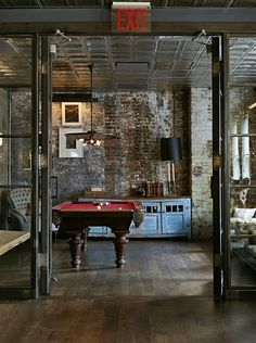 Exposed brick studio with pool table - via www.murraymitchell.com