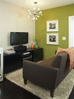 Beautiful green accent wall with matted photos