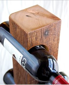 Bringing together the aged rustic feel of weathered barn wood with a modern sense of design, these free-standing wine racks are made from steel and solid pieces of reclaimed wood. Each securely holds four standard wine bottles and lets you display t