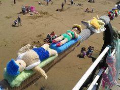 Guerilla knitting beside the sea.