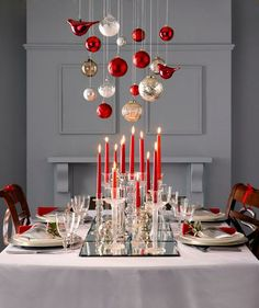 Pair rich shades of red with pops of metallics and focus on layers like creating a DIY runner out of mirrors.