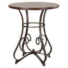 Enjoy Sunday brunch or gather friends for cocktails around this elegant pub table, showcasing a scrolling base and burnished medium cherry-finished top....