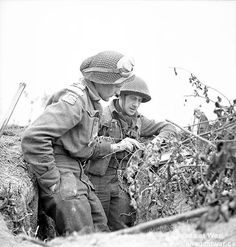 Caen - Carpiquet - Officers of the Queen's Own Rifles of Canada discussing tactics. July 8, 1944, Carpiquet, France.