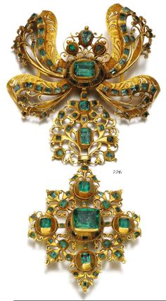 A Georgian gold and emerald pendant, first half of the 19th century. The bow surmount suspending a pectoral cross of openwork scroll design, set with foil backed table-cut emeralds. Marker's marks. #Georgian #antique #pendant