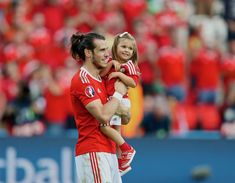 Wales' Gareth Bale and his daughter Alba Violet after the 1-0 victory over Northern Ireland