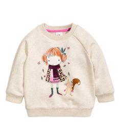 A redharied girl w/a squirrel playin in leaves Sweatshirt (powder beige) | H&M US