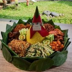 The name of this food is TUMPENG usually this food is made for traditional Indonesian events TUMPENG is made from rice flavored with Indonesian spices and then arranged like a mountain and added additional menus such as fried eggs meat and others.   #INDONESIA #FOOD #EVENT #RELEASEL