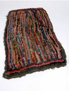 Antique Early Primitive Shirred Hooked Rug »
