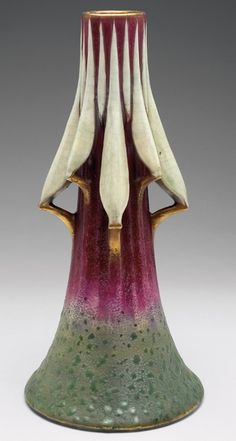 """Rare Amphora vase, known as the Praying Mantis Vase, sculpted and applied cyclamen buds, the body is covered in a mottled red to green glaze with gold accents, marked, #1110, 7.5""""w x 15.5""""h, similar vases are pictured in House of Amphora, by R. Scott,"""